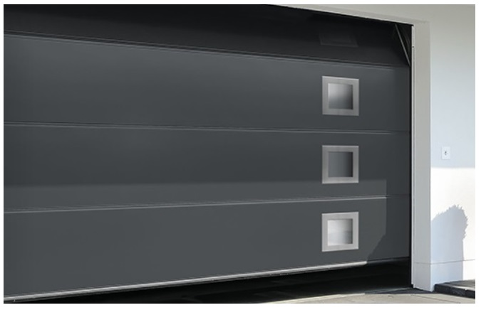 Porte de garage sectionnelle plafond en acier isolée 40mm. Grand choix de personnalisation. Hublot, motifs, couleurs et intégration d'un portillon.